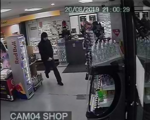 A man allegedly threatened a petrol station shop attendant with a knife before stealing cash...