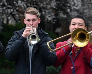 Four young Dunedin brass musicians (from left) Harry Smith (euphonium), Logan Ford (cornet),...