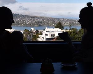 Patrons at the fire station-turned-cafe take in the city while enjoying their coffee. PHOTO:...