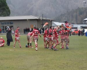 Clutha players celebrate their 24-14 victory over Arrowtown in the Countrywide final at Jack Reid...