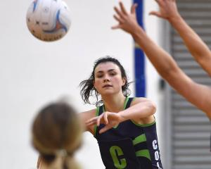 College centre Julia Law throws a pass during her side's loss to St Hilda's Senior A at the Edgar...