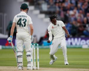 England's Jofra Archer celebrates taking the wicket of Australia's Cameron Bancroft. Photo:...