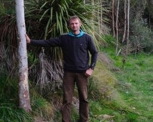 Gary Fleming is keen to promote more durable timber, such as this Eucalyptus argophloia tree....