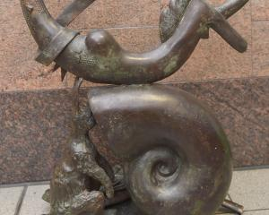 The mermaid statue sits inside the Dunedin central police station after it was knocked off its...