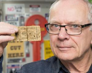 Dennis Shrimpton holds a 1738 United States bank note he brought off eBay. Written on it is ...