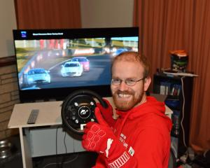 Champion Gran Turismo player Simon Bishop, at his racing console inside his Dunedin home. Photo:...