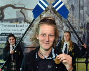 Eva Hofmans was greeted by schoolmates at Dunedin Airport yesterday as she returned from a gold...