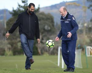 Otago Muslim Association president Dr Mohammed Rizwan (OMA United, left) kicks a ball around with...