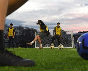 The Roslyn youth team trains at the artificial turf at Logan Park yesterday evening. PHOTO:...