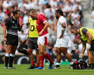 Gareth Anscombe leaves the field after being injured against England at the weekend. Photo: Getty...