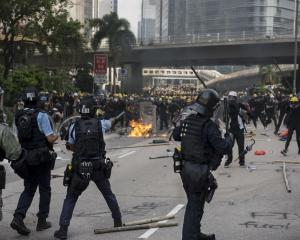 Police and protesters face off during a protest in Hong Kong on Saturday. Photo: Getty Images