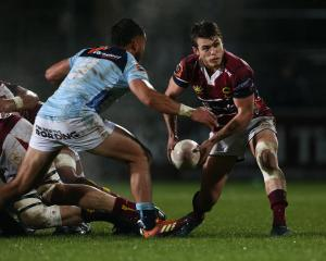 Southland halfback Logan Crowley passes the ball under pressure from his Northland counterpart,...