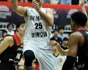 Ethan Rusbatch, of the Tall Blacks, makes a shot in their game against Japan in Kawasaki on...