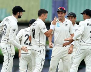 New Zealand's Trent Boult (C) celebrates with teammates after taking the wicket of Sri Lanka's...