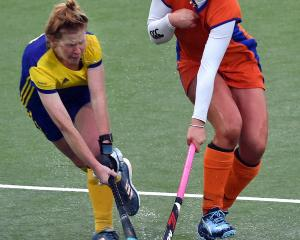 Julia Boothroyd (left), of the Taieri Tigers, is challenged by Olivia Allan, of City Highlanders,...
