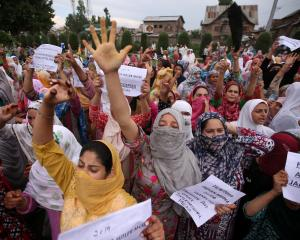 Kashmiri women shout slogans at a protest in Srinagar. Photo: Reuters