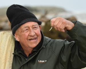 John Crossan admires his catch on opening day of the whitebait season in Southland yesterday....