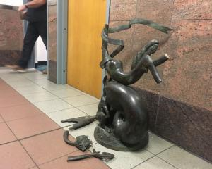 The mermaid sculpture was left in pieces after the incident. Photo: George Block