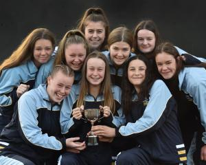 The Taieri College year 10 netball team with the trophy they won in Christchurch recently. Back...
