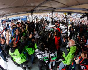 The Hyundai Motorsport team at the service park celebrate Paddon's 2016 win at Rally Argentina....