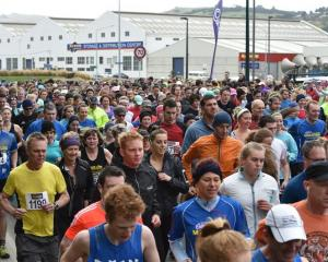 Runners head off from the starting line at the Cadbury Dunedin Half marathon. Photo by Gregor...