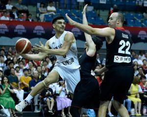 Shea Ili prepares to pass for the Tall Blacks during last night's loss to Japan. Photo: Getty Images