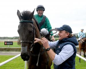 Waipukurau trainer and part-owner Simon Wilson greets jockey Chris Johnson in the birdcage at...