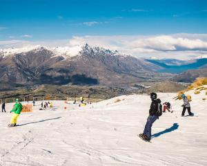 Skiers and snowboarders enjoy the season's first day at Coronet Peak. Photos by Chris Hoopman/NZSki.