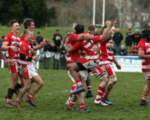 Clutha players celebrate at the final whistle of the Southern regional final at the Balclutha...