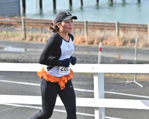 Sue Kim makes her way through St Leonards during the Port Chalmers to Dunedin Road Race on...