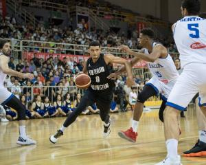 Tai Webster drives to the hoop for the Tall Blacks against Italy. Photo: Getty Images