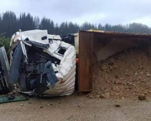 A truck and trailer at the mining site was pushed over and the cab smashed in. Photo: Supplied