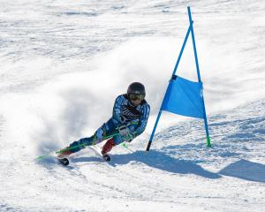 Twizel skier Willis Feasey on his way to winning the national giant slalom title at Coronet Peak...