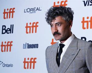 "Taika Waititi arrives at the world premiere of ""Jojo Rabbit"" at the Toronto International Film..."