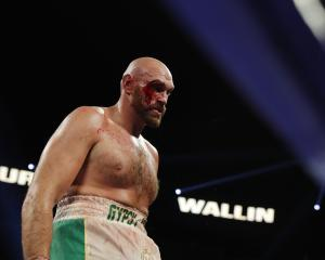 Tyson Fury overcame a deep gash to his eyebrow and a spirited performance from rank outsider Otto...