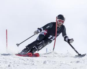 Kiwi alpine skier Adam Hall navigates the slalom course at Cardrona yesterday on his way to...