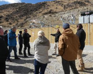 Pioneer Energy engineer Tony Jack takes residents on a tour of the site during yesterday's...