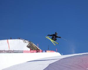 American freeskier Birk Irving ramps the halfpipe on the way to victory during the Winter Games...