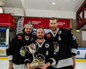 Ice Blacks' players (from left) Liam Stewart, Jordan Challis and Matthew Schneider celebrate...