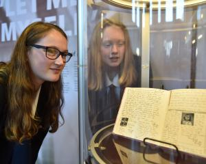 Otago Girls' High School pupils Grace Twaddle (left) and Victoria Couper examine a replica of the...
