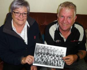 Methven High School class of 1969 students Judith Lilley and Kit Kennedy with a copy of the old...