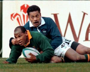 South Africa's  Chester Williams scores the second try for his team June 10 during the quarter...