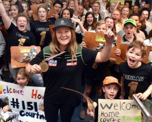 Women's motocross world champion Courtney Duncan celebrates with her fans at Dunedin Airport...