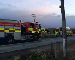 Emergency services at the scene of a serious crash near Outram today. Photo: Gregor Richardson