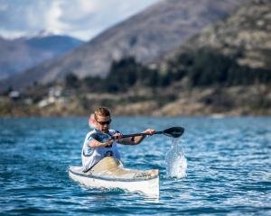 Peak to Peak winner Hamish Fleming paddles on Lake Wakatipu on Saturday. PHOTO: SEAN BEALE