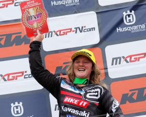 Courtney Duncan celebrates on the podium after winning the penultimate race of the season in...