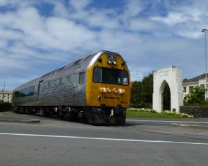 Dunedin Railways' Silver Fern Railcar, heading south past the Garden of Memories in Oamaru. PHOTO...
