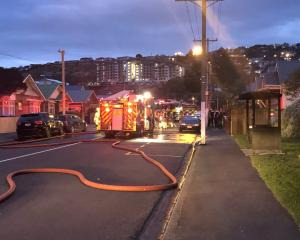Fire crews at the scene of a house fire in Macandrew Rd. Photo: Tim Miller