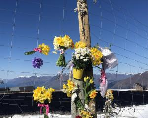 Flowers were laid to remember the woman who died in a skiing accident at Coronet Peak on Saturday...