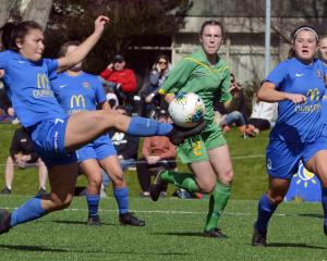 Southern United player Shontelle Smith controls the ball with teammates Emily Morison (right) and...